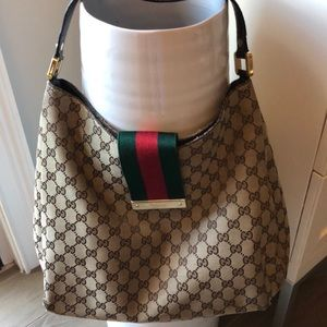 Gucci canvas hobo with green and red closure flap.